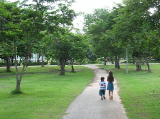 My kids walking in the park