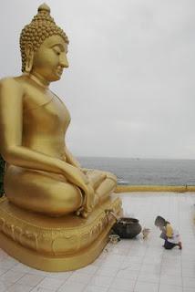 My son and Buddha image at Koh Kaew Yai