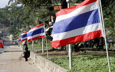 Thai flags blowing in the wind at Karon Beach