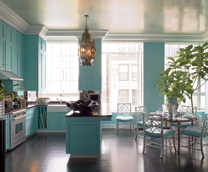 This kitchen is the opposite of neutral, with bold turquoise cabinets