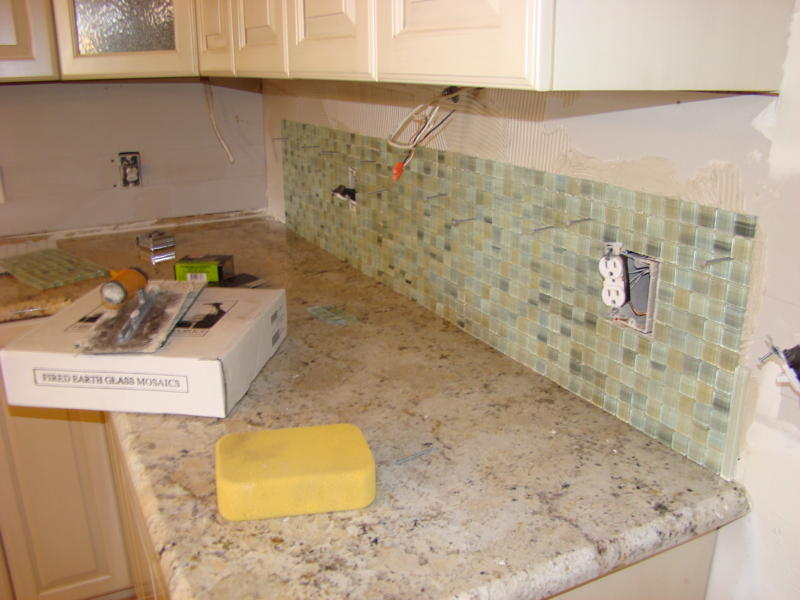 you can simply not go wrong with a glass mosaic backsplash
