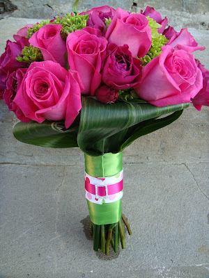 Bouquet of Ravel roses, hot pink spray roses, & green hydrangea.