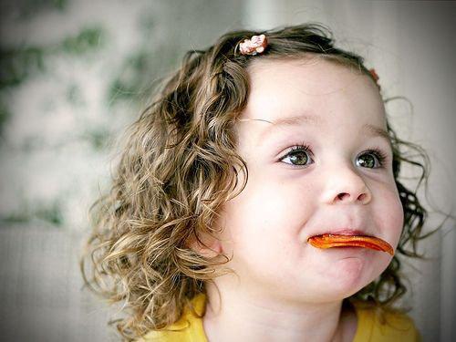 Cute Baby girl earting snacks