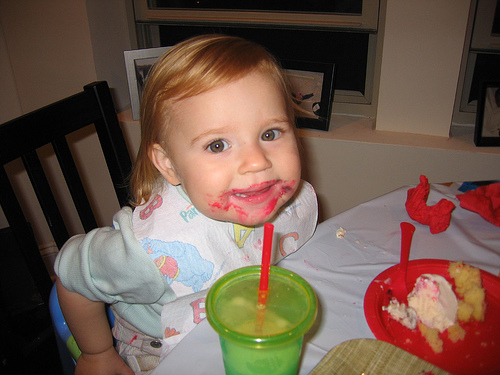 Cute baby girl bith day icream eating photo