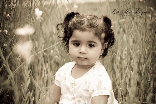 Cute Baby girl in flower garden