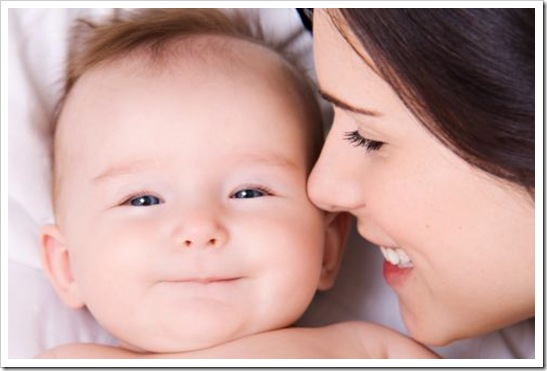 Cute baby with mother thumb photo
