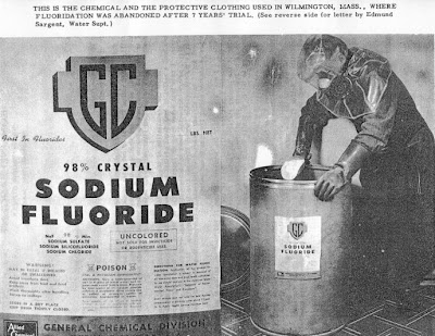 A worker adding fluoride to a cities tap water. Rest assured that underneath the hazmat helmet is a cavity free smile.