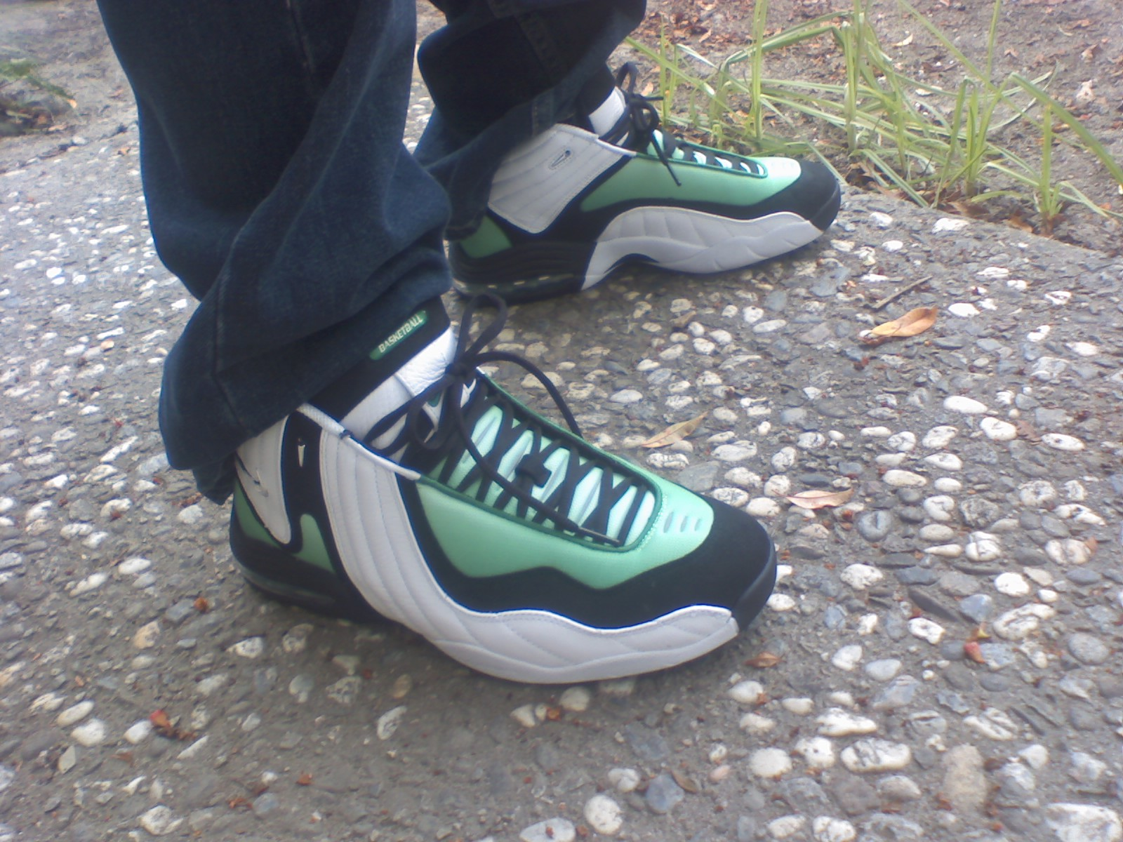 MATERIALS: The white parts are leather, green parts are mesh, and the black  parts are nubuck. The midsole is white and black with green showing through  the ...