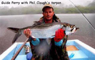 Photo of Mango Creek Lodge guide Perry holding a tarpon