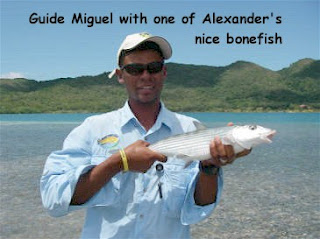 Photo of Mango Creek Lodge guide Miguel holding a bonefish