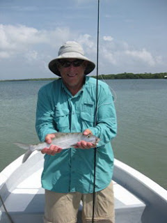Photo of William holding a bonefish
