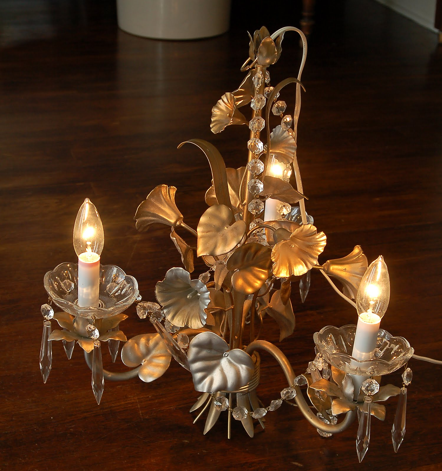 Hand painted tole chandelier makeover miss mustard seed it was spray painted a tacky gold and the previous owner stuck some crystal cups and swags on the candles it was very strange but i could see the arubaitofo Choice Image
