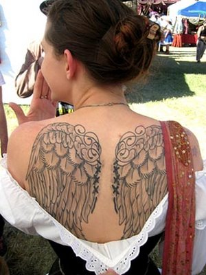 wing tattoos on back for girls. wing tattoos on back