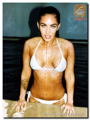 Megan Fox bikini photo shoot for the GQ Magazine.Megan Fox lusty lips on the