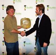 Redmond High teacher Mike Town receiving award from Phillipe Cousteau