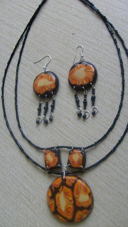 komplet-medaljon ogrlica i mindjuse