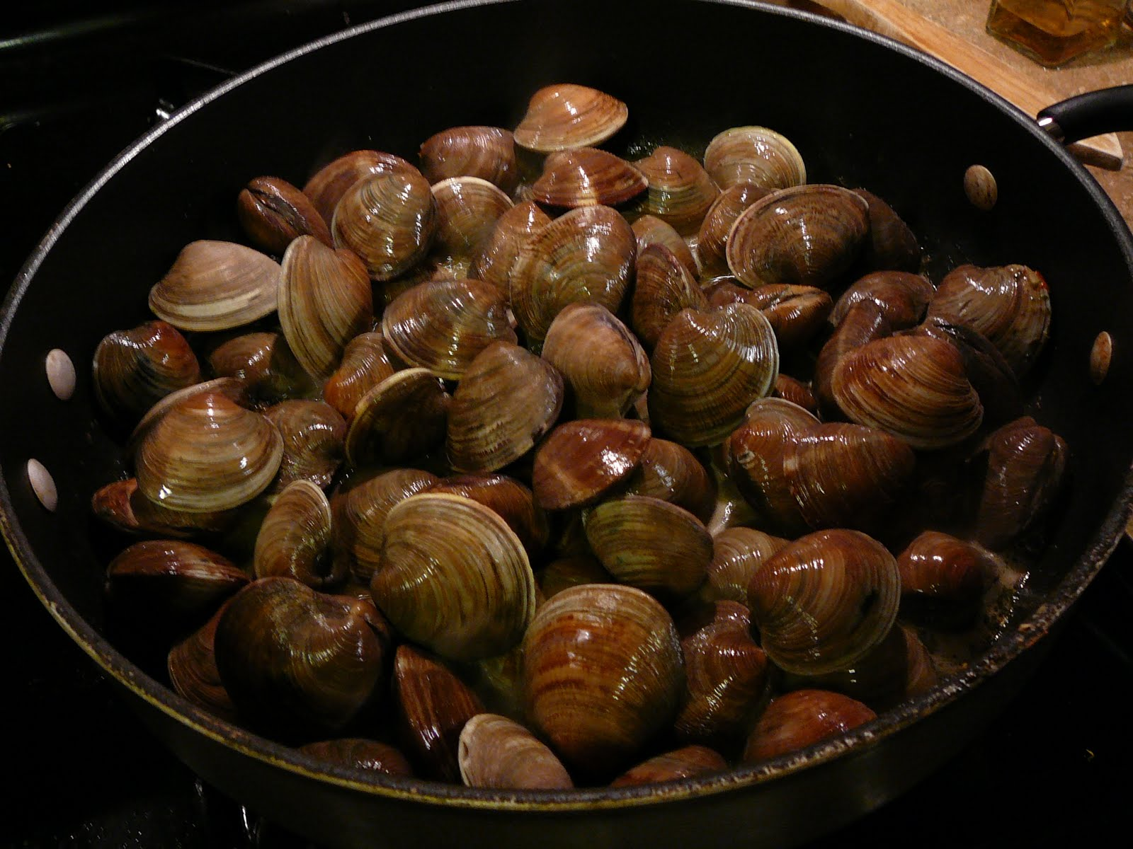 Toss in your unsuspecting clams, then cover and let steam for about 10 ...