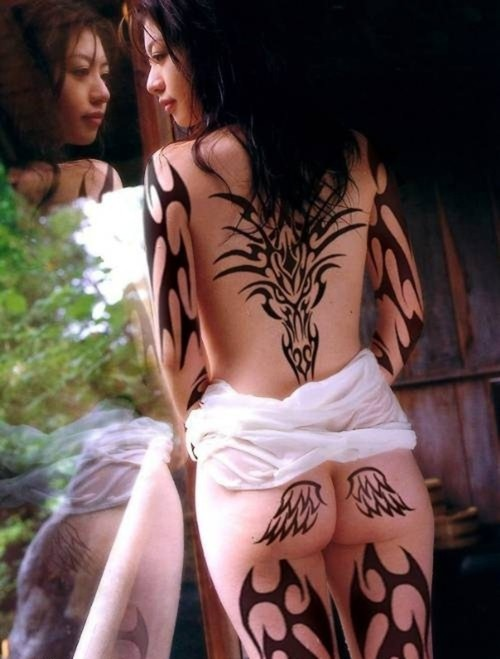 Some people like the idea of having their tribal tattoo on the back of their