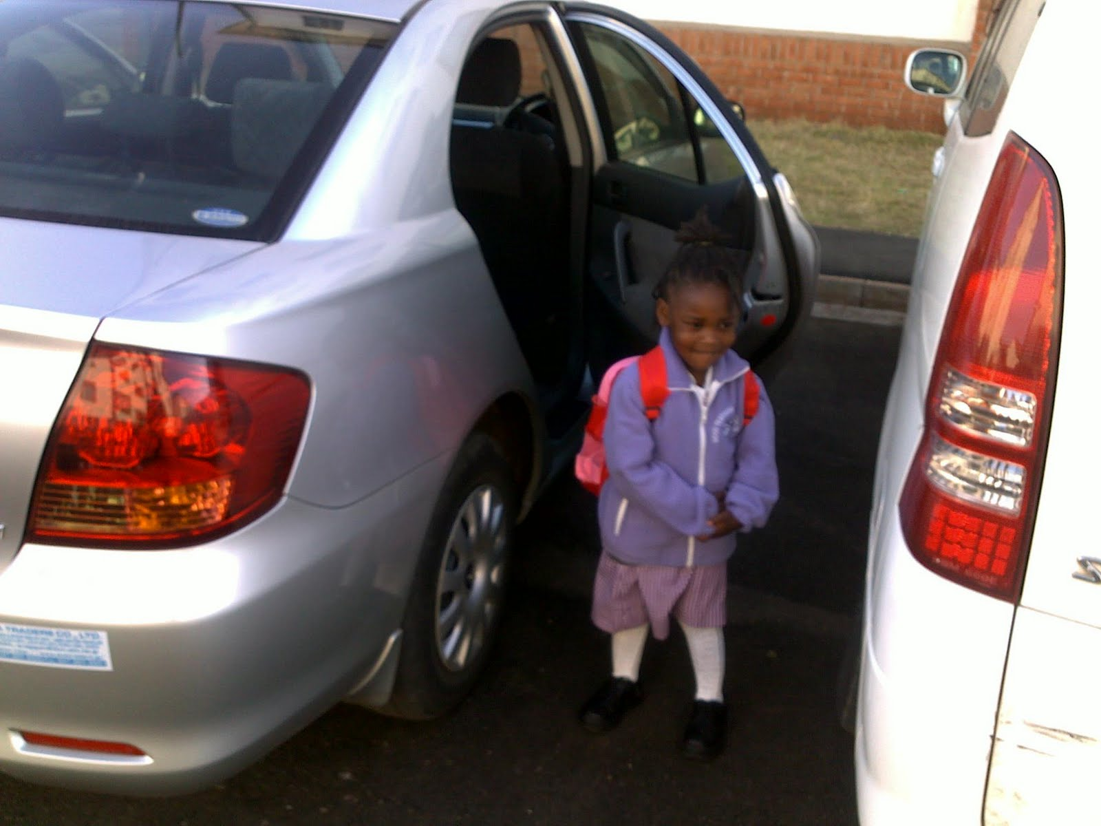 Imani%252Bby%252Bcar Imani ready for the ride to school. I heard she cried on the first day ...