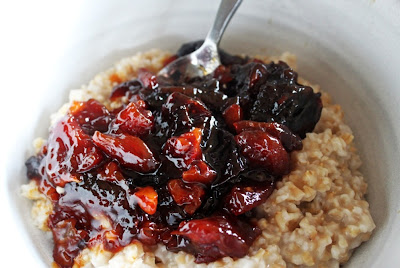 Stewed apricots and prunes in a flavorful syrup of clementine, red wine, and honey
