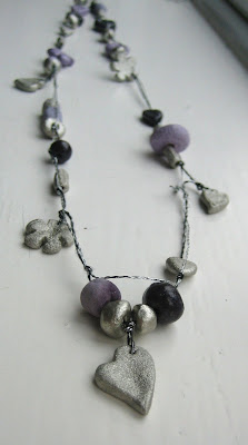 handmade long necklace with beads and charms