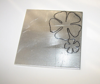 drawn flower on aluminium by surf jewels handmade jewellery