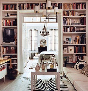 Love The Wall Made Into A Mini Library And How All Of The White Is The
