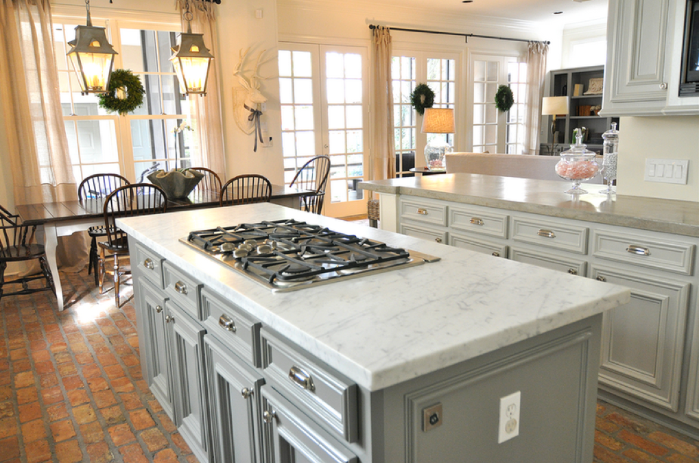 Grey paint finish on both island and cabinets surprise us