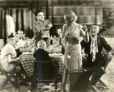 Angelo Rossito (standing on table) and Olga Baclanova (standing) in Freaks