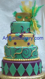 Four tier Mardi Gras birthday cake with feather mask topper