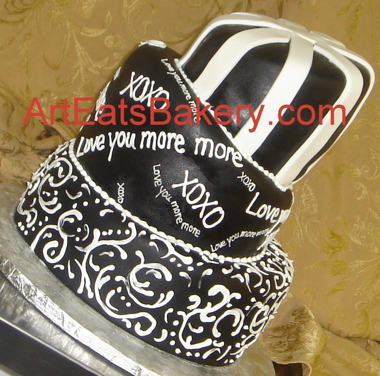 Black fondant mad topsy turvy custom wedding cake with white stripes