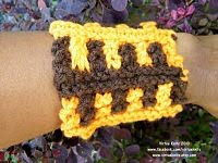 Orange and brown wrist cuff