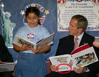 Bush apparently unaware he is reading upside down