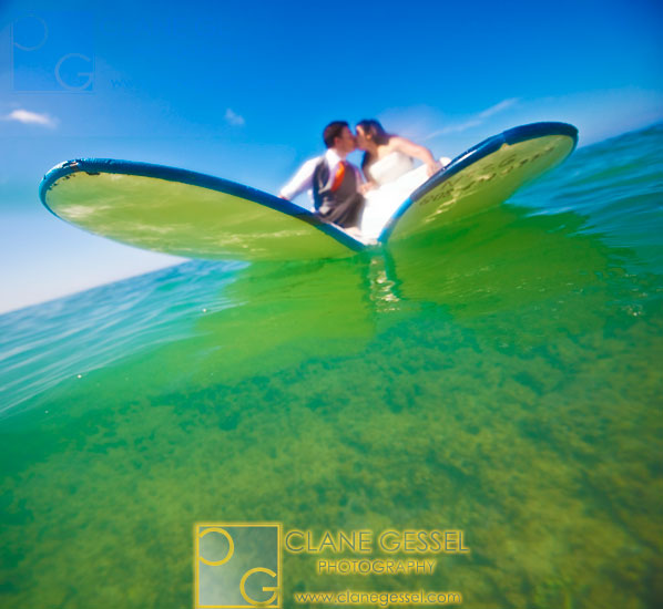 surfing in wedding dress, trash the dress photo