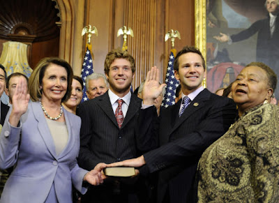 Who is the guy holding the Bible for Congressman Schock?