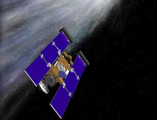 Recreación artística de la sonda Stardust atravesando la cola del cometa. NASA - JPL