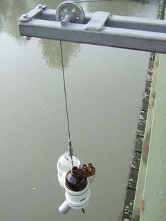 image of equipment retrieving water quality samples from a river that flows to Puget Sound