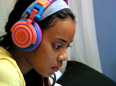 Tween Girl Listens to Music