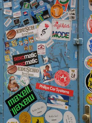 Mária utca, multinacionális, multi, multik, VIII. kerület, Józsefváros, Budapest, Magyarország, Hungary, street art, multinational, ads, advertisment, matrica, reklám, Ungarn