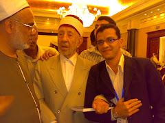 أسامة مرافق للعالم الدكتور البوطى بمؤتمر دولى