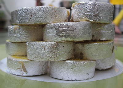 Silver Warq topped kaju rolls