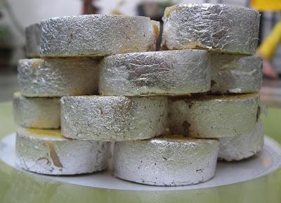 Silver Warq topped kaju rolls