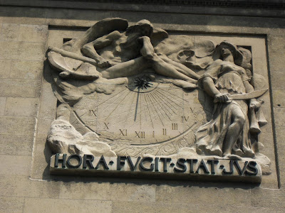 Interesting sundial on the side of an old Paris building