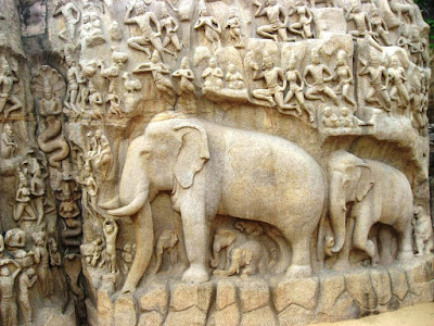 Elephant in the center and the pious on the bottom left round off Arjuna's Penance at Mahabalipuram