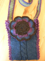 knitted bag with crochet flower