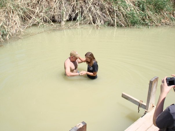 Getting baptized in the Jordan river.
