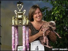 World's Ugliest Dog with trophy