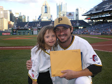 Chloe presents citations to Andy LaRoche for his outreach to children with Down syndrome