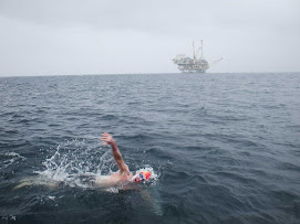 Chris - Swimming past the oil rigs