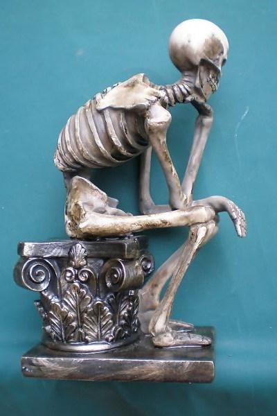 "MrSkeleton ""Thinker"" statue"